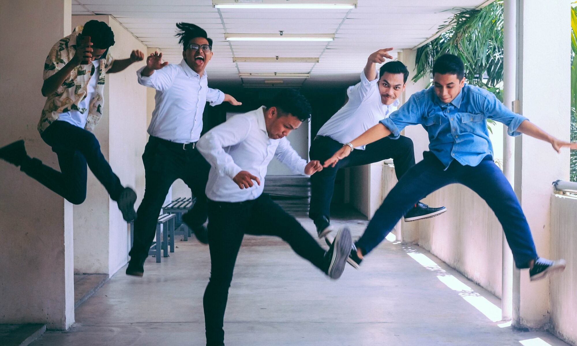 People jumping in an office cooridor.